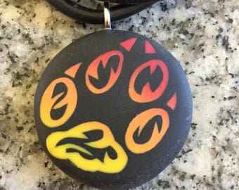 Fire FOX Paw Print hand carved on a polymer clay black color background. Pendant comes with a FREE necklace