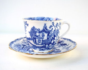 Vintage teacup and saucer Royal Albert crown china England white blue gold teacup bone china oriental design tea party Chinoiserie teacup