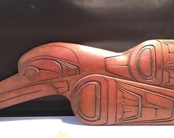 Iniut artisan James Lewis wood carved Raven .