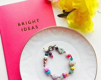 Colorful beaded bracelet. Hot pink, mint,yellow, violet beaded bracelet. Made with Czech glass, bone, and lampwork beads.