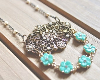 Edwardian inspired antiqued gold and bronze large filigree penant necklace with rhinestone, pearl, and turquoise flower accents