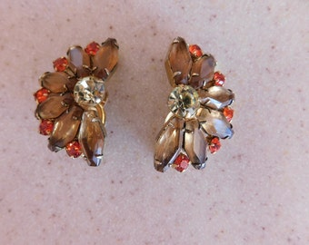 Glamorous Prong Set Dressy Earrings - Comfortable ClipOns - Beautiful Design- Gorgeous Red Rhinestones compliment taupe ovals