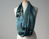 hand dyed and printed silk infinity scarf in teal and navy blue black with linden leaves