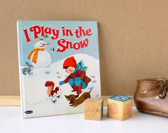 1967 I Play in the Snow Tell-A-Tale Book by Whitman. By Donna Lugg Pape. Illustrated by Bonnie & Bill Rutherford. Children's Storybook.