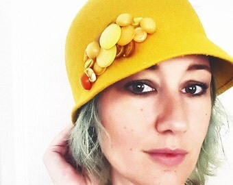 yellow felt cloche hat with cluster of vintage buttons yellow gold rust sunset