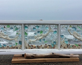 Three mermaids swimming in a vintage window all pale tones beachglass