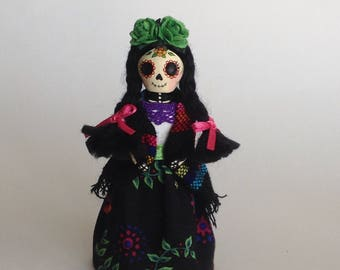 Small Mexican Catrina. Clay doll. Day of the Dead.