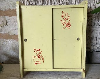 Antique wooden doll wardrobe