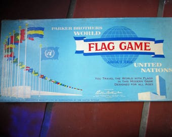 World Flag Game About the United Nations - 1961 Board Game by Parker Brother - all there in good condition  RARE