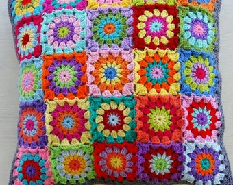Crochet patchwork granny square cushion cover in grey edging