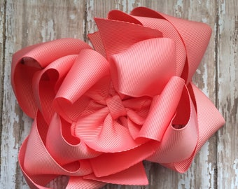 Girls medium triple stack coral hair bow
