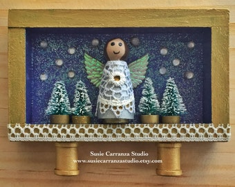 Silver Angel - small wood diorama.  Wood angel, glittery purple background. Mini Christmas trees.