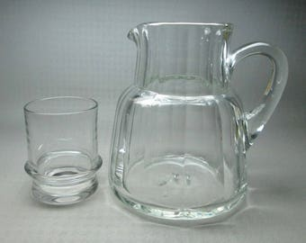 Blown glass pitcher , bedside with cup / glass , looks to have been blown into a mold , has a pontil on the bottom ,