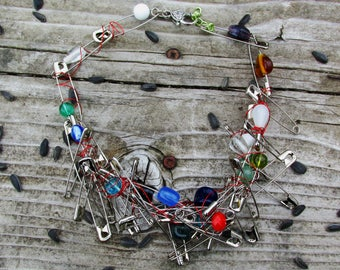 "Safety pin, wire, and glass bead statement necklace, ""Trouble"""