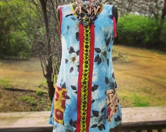 S. The million button dress. Upcycled dress dyed with indigo dye. Large pockets.