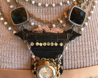 Dramatic , chic hinge necklace with found objects. Shown layered with other necklace .