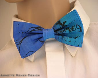 blue turquoise bowtie out of painted silk handprinted black lines