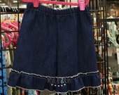 Size 8 denim ruffled shorts.  Clearance free shipping.