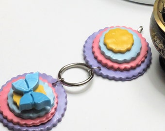 Pastel stacked medallion polymer clay pendant