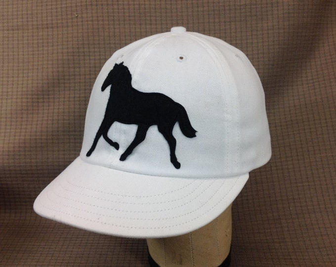 Cotton twill 6 panel cap with wool felt applique horse meticulously stitched with details.