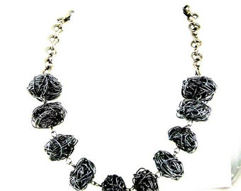 Metal necklace. Black wire. Stylish design. Ready to ship.