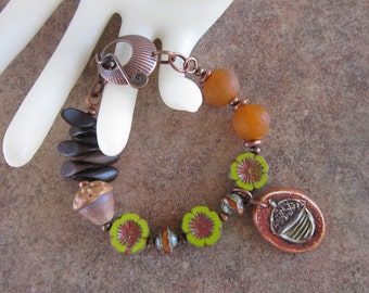 Woodland Rustic Earthy Yellow Green, Orange, Brown, Polymer Clay and Ceramic Acorns, Recycled Glass, and Wood Copper Bracelet