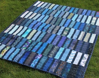 Scrappy Blue Quilt in a Large Lap Size