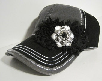 Two Tone Black and Gray Distressed Trucker Baseball Cap Hat with Black Chiffon Flowers and Silver and Black Stone Accent