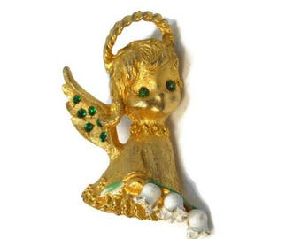 SALE MYLU cherub brooch, book piece, gold tone, angel brooch pin, girl with green rhinestone eyes and wing accents, carrying lily of the ...