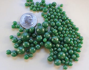 Vintage graduated dark green round glass loose bead - 4-12 mm. about 160