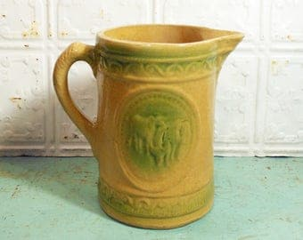 Yellow and Green Salt Glaze Stoneware Pottery Pitcher Cows