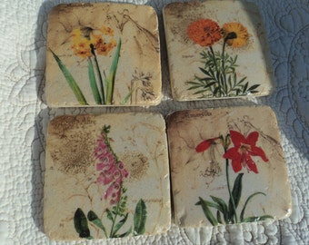 Lovely ceramic coasters portraying different flowers and backed with cork for additional protection