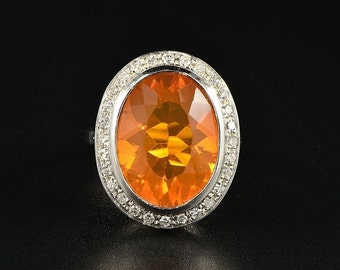 An impressive 8.00 Ct natural fire opal and diamond vintage ring