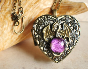 Dragon music box locket, heart shaped locket with music box inside, in  bronze with dragon and bronze filigree on front cover.