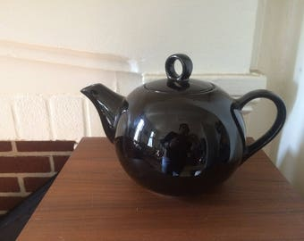 Cute Roundness of a Black Teapot