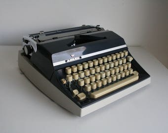 Vintage. Gray. DDR. Adler. Typewriter with original papers Excellent condition