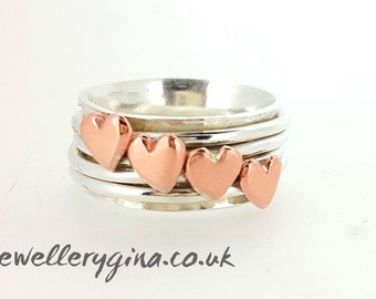 Silver spinning ring (silver worry ring) with copper hearts. Twinkling hand-hammered solid silver ring set with four  copper hearts.