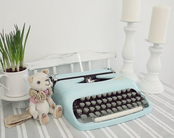 Consul light blue small working condition portable typewriter with case
