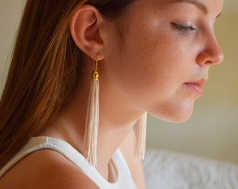 Long golden earrings Tassel's son
