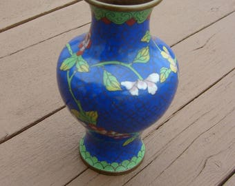 Cloisonne at its best. Beautiful blue and gold  background with greens, yellows, pinks, reds accent colors