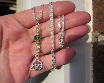 CELTIC KNOT charm w. AB Green faceted Swarovski crystal beads & star spacer pendant w. silver pltd chain.