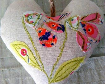 Appliqued heart decoration, flower applique, free motion embroidery heart.