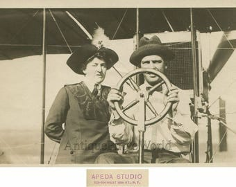 6190 Title: Aviator pilot on early biplane airplane antique photo