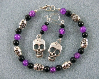 Bracelet and earring set- purple crackle glass and skulls