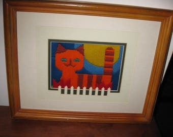 folk art cat embroidery the look and colors of the seventies matted in white fence motif matt wood frame 12 x 15 12