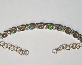 6.75ctw 7x5 mm Ethiopian Opal Sterling Silver Adjustable Bracelet 6.50-8 inch