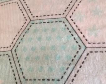 a standard pillowcase in a quilt print