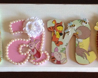 Winnie The Pooh name sign. Perfect for a baby nursery. Handmade item and made to order