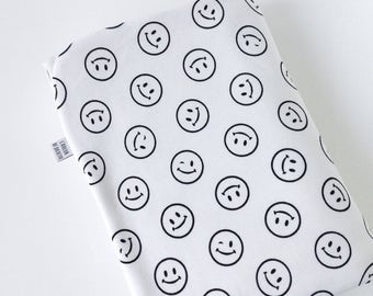 White baby blanket with black smiley print