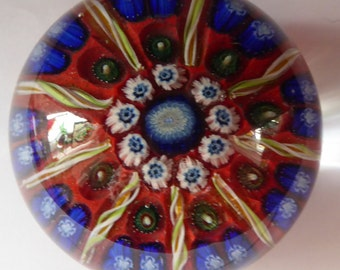 Beautiful VASART Scottish Glass Paperweight with 9 Spokes; with scarlet ground, latticino canes & millefiore. 3 inches diameter